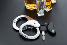 Handcuffs, car keys and alcohol - DUI Defense in Boise